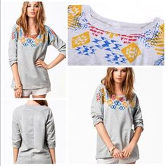 Grey Aztec Print Top Casual grey top with Aztec print near the top. Pair perfectly with denim or leggings. Made of a cotton blend Tops Tees - Long Sleeve