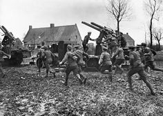Anti-Aircraft men rushing to their guns at Armentieres, March 1916.