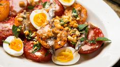 Charred Tomatoes With Egg, Anchovies and Bread Crumbs Recipe - NYT Cooking Small Tomatoes, Cherry Tomatoes, Olive Recipes, Fennel Salad, Summer Tomato, Roasted Salmon, Vegetable Dishes, Veggie Food, Bread Crumbs