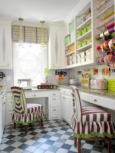 Sewing desk and cabinets... cabinet storage on either wall, fabric in bins underneath? I love the chairs