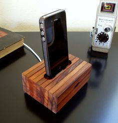 iPhone 4 Cradle - Reclaimed Wood - iPhone Charger w/o wall adapter. $66.00, via Etsy.