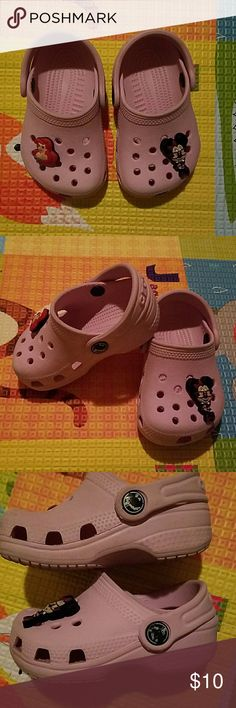 Girls crocs Pink adorable crocs, used but in good condition,  croc logo is almost gone, but the shoes have minimal signs of wear mini mouse and Ariel charms included. Crocs  Shoes Water Shoes