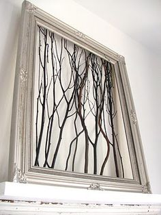 Find a picture frame at Chez Thrift or The ReUstore and turn it into a fireplace mantel decoration. Spray paint the frame, and even bring nature inside your home by using elements from your yard. Wooden sticks work great!