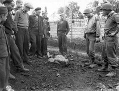 May 1945 A group of liberated political prisoners and two soldiers from the Armored Division of the Third U. Army look at the body of a camp guard killed by survivors after liberation. Army Look, Dramatic Photos, Political Prisoners, Mans World, World War Two, Wwii, The Past, Camping, Soldiers