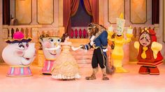 The Beast dances with Belle on stage while Lumiere, Cogsworth, Mrs. Potts and Chip look on in glee...l Beauty & the Beast Live on Stage at Hollywood Studios l #WDW2017