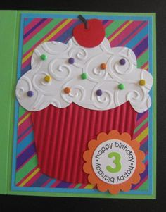handmade birthday card  by Penny Strawberry  ... giant punch art style cupcake ... luv how she put together various elements ... paper crimper texture for cupcake paper ... swirls embossing folder texture and cloud die cut ... little brads/candy dots for sprinkles ... happy paper in bright primary colors ... wonderful card!!
