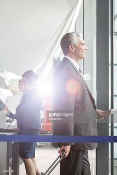 Stock Photo : Businessman with boarding pass and passport at the airport