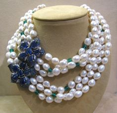 I like the asymmetry of this, but smaller pearls, clear crystals where they have green, and some thing different for the broach, but maybe still blue???