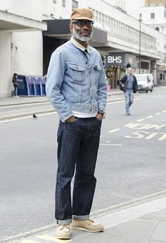 A gentleman wears double denim.