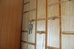 Key cabinet in Oak with a bookedmatched Yew panel and Wenge handles.