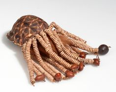 Botswana | Compact with powder puff from the Kung Bushman from Western Ngamiland/Dobe | Tortoise shell, ostrich shell beads, fur, powder, leather, seeds and cord. | ca. 1971