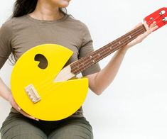 "Have a geeky jam session with this Pac-Man shaped ukulele. This fully functional ukulele is made out of maple with an ipa fretboard. These ukuleles are also available in various styles such as  Steampunk, Transformers, Cupcake, and Panda style via <a href=""http://www.etsy.com/shop/celentanowoodworks"" rel=""nofollow"" target=""_blank"">Celetano's</a> shop."