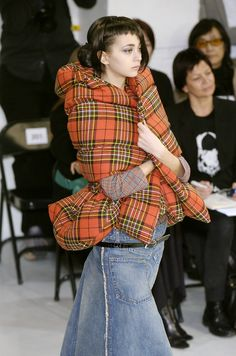 For some reason I love this. It's a weird space Scottish jacket. Junya Watanabe.
