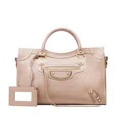 I absolutely love the Balenciaga City Bag ($2,125) with the metallic edge from the label's holiday collection. The rosy shade is so perfect for every season, it's a must-have bag I'll wear for the rest of my life.  — SW