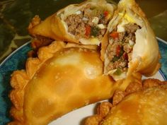 Empanadas de carne (em-pa-nadas, d'-car-neh) simply delicious! walk into any spanish restaurant and ask for this, only if they add olives to the mix. Peruvian Recipes, World Recipes, Mexican Food Recipes, Beef Recipes, Cooking Recipes, Ethnic Recipes, My Favorite Food, Favorite Recipes, Chicken Empanadas