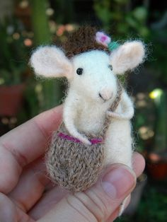How adorable!  This little needle-felted mouse is going on a journey.  :-)  by feltingdreams