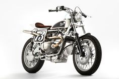 BMW street tracker based on a 1979 BMW R100 RS. Built by Fuel Motorcycles, it has Ohlins shocks, Mikuni carbs with K&N filters and handmade high exhaust pipes exiting through aluminum side panels.