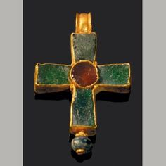 Early Byzantine Period, Circa 3rd - 5th c. CE Dimensions: 2,8 x 1,8 cm Material: Glass & Gold Condition: Intact Region: Western Asia