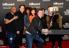 Charlie Burchill and Jim Kerr and the band Simple Minds take a selfie at Radio Row during the 2015 Billboard Music Awards at MGM Grand Garden Arena on May 15, 2015 in Las Vegas, Nevada.