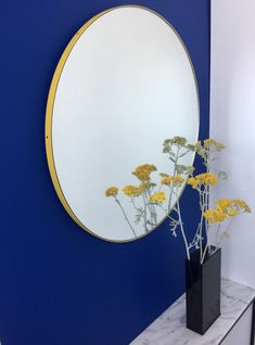 "Delightful hand crafted black round mirror with a funky yellow frame.  Ideal above a console table in the hallway, above a beautiful fireplace, in the bedroom or in the bathroom.  Design tip: looks stunning used as a cluster in different sizes and/or colours.  Framed mirror available in 20cm/7.9"", 40cm/15.8"", 50cm/19.7"", 60cm/23.6"", 79cm/31.1"" & 100cm/18.55"" (depth 18mm)."