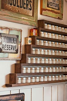 A custom walnut spice rack is surrounded by vintage signs unearthed at flea markets at home and abroad.