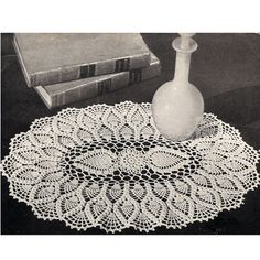 Oval Pineapple Centerpiece Doily Crochet Pattern:  This one is a large centerpiece beauty, with a dual pineapple motif in the center and then, surrounded by two more rows of pineapples.  The pineapple edges are filled in with a shell scallop.  You can make the doily in two different sizes - 14 x 21 inches, or 8 x 12 inches.