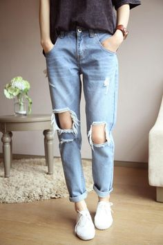 Boyfriend jeans. Buy the jeans new, pray they get holes in the front, and not the back.