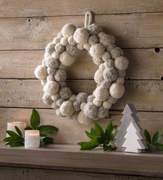 Plush poms embellish this cozy wreath for a touch of yuletide charm and texture, wherever it is placed. Features cream and gray handcrafted pom poms with a felted loop for hanging. Christmas Pom Pom Crafts, Indoor Christmas Decorations, Christmas Crafts, Xmas, Fabric Wreath, Diy Wreath, Wreath Making, Pom Pom Kranz, Indoor Wreath