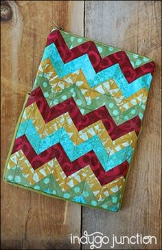 Indygo Junction's Travel Tech Pouches are travel cases perfect for protecting your tablets & eReaders. Pieced chevron design or grid-quilted flap features a zipper closure pouch ideal for holding your cords & headphones. Two inner storage pockets plus a Velcro tab keeps your flap in place while protecting your pockets. $11.99 #tech #purse #organization