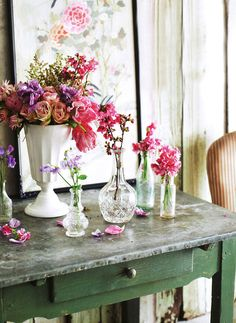 flowers in little jars