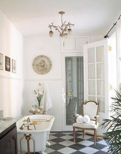 Inspiration from Bathrooms.com: Looking for a classic approach to glamour? Choose an antiqued brass finish for taps, light fittings and furniture, and match it with cool creams and whites. #ensuitebathrooms #bathrooms #chandelier