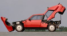 Lancia Delta S4 Stradale, 1985. For homologation purposes Lancia built 200 road-going versions of the Delta S4 Group B WRC car of 1985/86, after which Group B cars were banned from competition. The S4 succeeded the Lancia 037 combining a supercharged and turbocharged version of that car's mid-engine with four-wheel drive.
