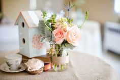 Katelyn James Photography DIY Garden Inspired Wedding. Birdhouses and pink roses centerpiece!