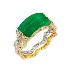 Unique pair of jadeite, ruby, emerald, yellow diamond and diamond bangles