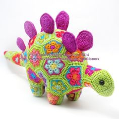 Puff the Magic Stegosaurus African Flower Crochet Pattern. Really awesome animal and other crochet patterns from Heidi Bears Crochet African Flowers, Crochet Puff Flower, Cute Crochet, Crochet Motif, Crochet Crafts, Crochet Dolls, Yarn Crafts, Crochet Flowers, Crochet Projects