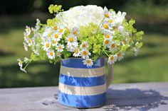 All I could find worth picking today were a spray of white roses, some feverfew and a few frothy stems of lady's mantle. And that was enough to make a very pleasing posy. Perfect for a Cornishware jug.