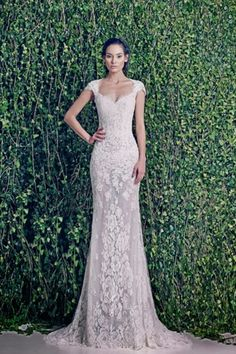 LOVE. This makes her look 7 ft tall but i like the dress.  WEDDING DRESSES: ZUHAIR MURAD BRIDAL FALL 2014 - Fashion Diva Design