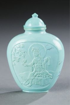 : A Chinese turquoise snuff bottle with relief carved panels on each face. c.1800-1880. Estimate: $2000-$3000.