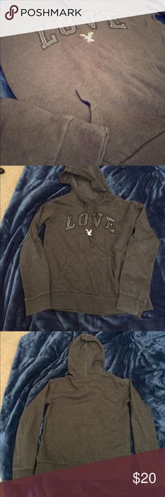XS American Eagle Pullover This is a classic cool American Eagle pullover. It has a cool, shiny AE logo under the word love. Other than some light fading at the seams from washing, there are no problems with this sweater and it is homeroom or campus ready! American Eagle Outfitters Tops Sweatshirts & Hoodies