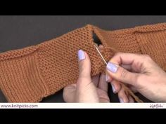 This video shows how to seam together two pieces of garter stitch pieces, when side by side. This simple technique makes for a clean and polished look that is nearly seamless.