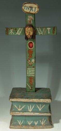 his piece is composed of several carved pieces of wood, the cross sets into a slot in the base and is secured with a nail. The crucifix is p...