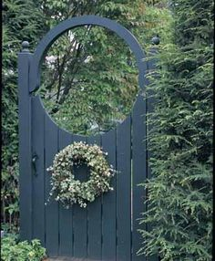 "Basking Ridge Gate - The dramatic, handcrafted board gate serves as an impressive entrance through hedge or other shrubbery. Together, the concave gate and arch blend seamlessly to form a perfect circle through which to view your landscape. 5 1/2"" wide boards, 4 1/2"" sq. posts for cedar and 4"" sq. for vinyl, topped by a 3 1/2"" single arch. Gate hardware consists of a thumb latch and two 12"" heavy reversible strap hinges. The gate is 60""H, 48""W, and 92"" overall height with the arch. Pre"