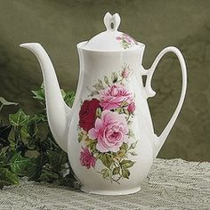 Chocolate teapots are all the rage again and this Summertime Rose pattern is sure to be a popular choice for years to come.  It features generous pink and burgandy rose bouquets and has a stately appearance.  Made in England of fine bone china, this chocolate pot can also hold coffee or tea.   Capacity - 30 ounces.