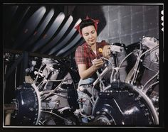 (Courtesy  |  Library of Congress) A woman works on an airplane motor at North American Aviation, Inc., plant in California. June 1942.
