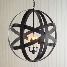 """Metal Strap Globe Lantern - Large Rotating metal straps in an industrial inspired oxidized Iron finish, orbit around three candle lights. Straps can rotate to create unique looks or form a globe shape as shown. 3x40 watts. (candle base socket) (25""""Hx24""""W)"""