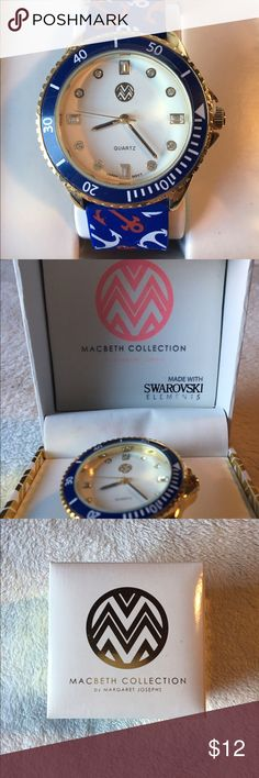 Brand new, never worn Macbeth nautical watch. New in box blue and red nautical watch from the Macbeth Collection by Margaret Josephs. Thus watch is sold as a men's style, but could very much be worn as a women's. Beautiful Swarovski elements and cute anchor design. Margaret Josephs  Accessories Watches