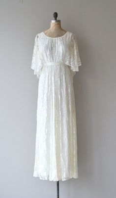 Ethereal vintage 1970s white lace wedding dress with supple and airy lace, dreamy flutter lace shoulder/sleeve and back capelet, slight empire waist,