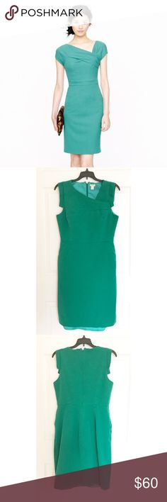 "J. CREW Origami Sheath Dress This beautiful green dress is fully lined & features an origami neckline & a slit in the back. I believe one of the threads holding the lining stretched while in the washer to make it the exact length of the dress when worn. It's 38"" in length. The bust is 18"", waist is 15"" & the hips are 18"". The dress is 52% cotton, 41% viscose & 7% elastane. It should be machine washed cold & tumble dried on low. J. Crew Dresses Midi"