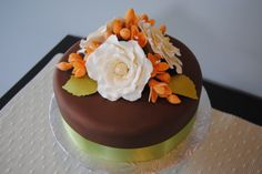 Decadent chocolate cake with cream open roses  orange freesias. fall wedding by the Handmade Cake Company