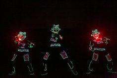 <p> A trio of iLuminate dancers in L.E.D. suits performed at Alienware's laptop launch during the Electronic Entertainment Expo in...
